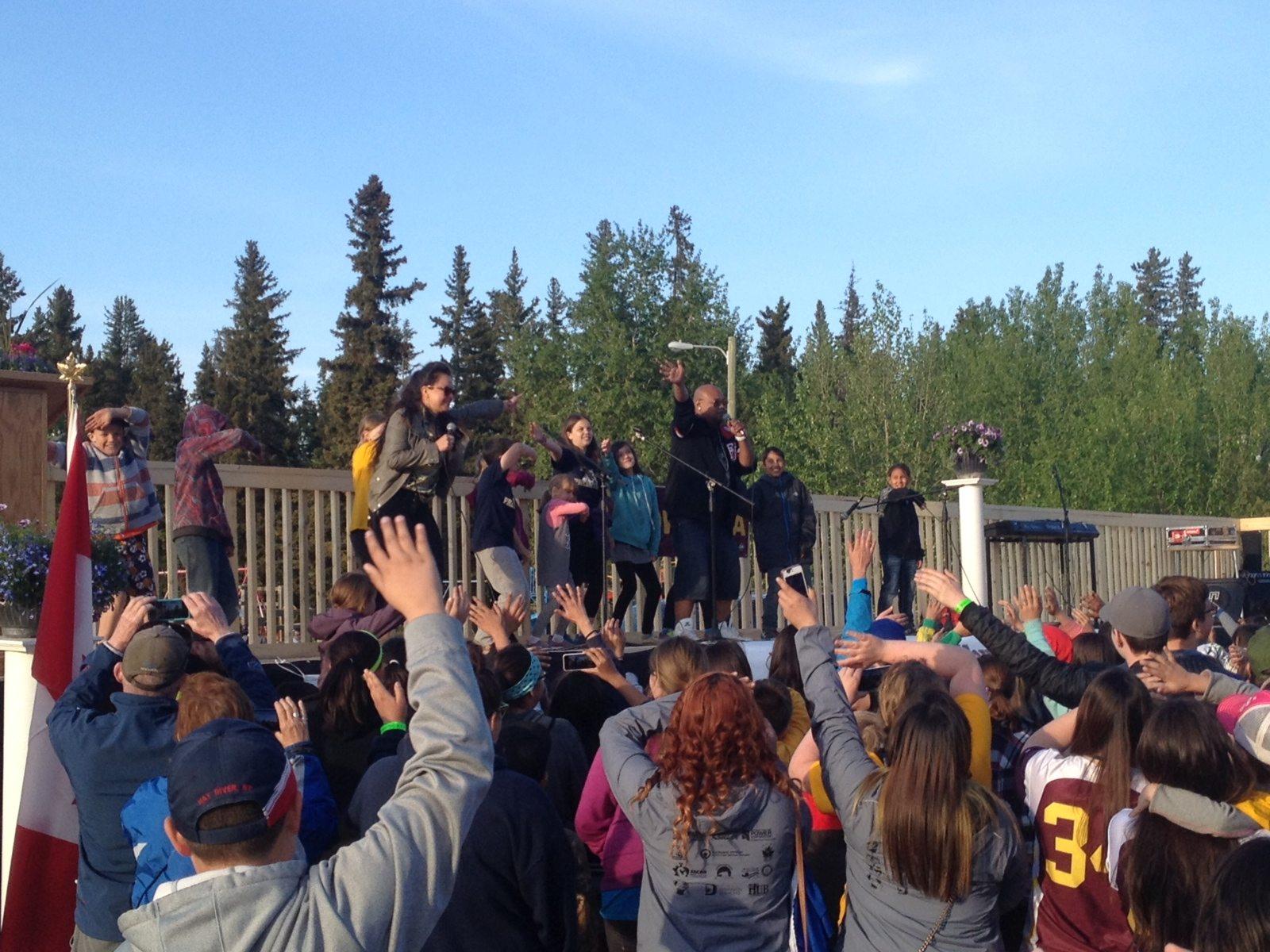 Athletes and spectators dance to Godson during Wednesday night's opening ceremony