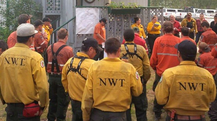 A briefing for fire crews tackling a wildfire south of Hay River in July 2015