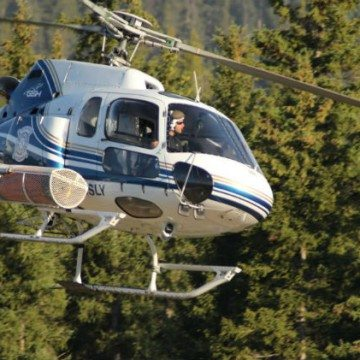 Helicopter works on wildfire near Hay River, July 2015