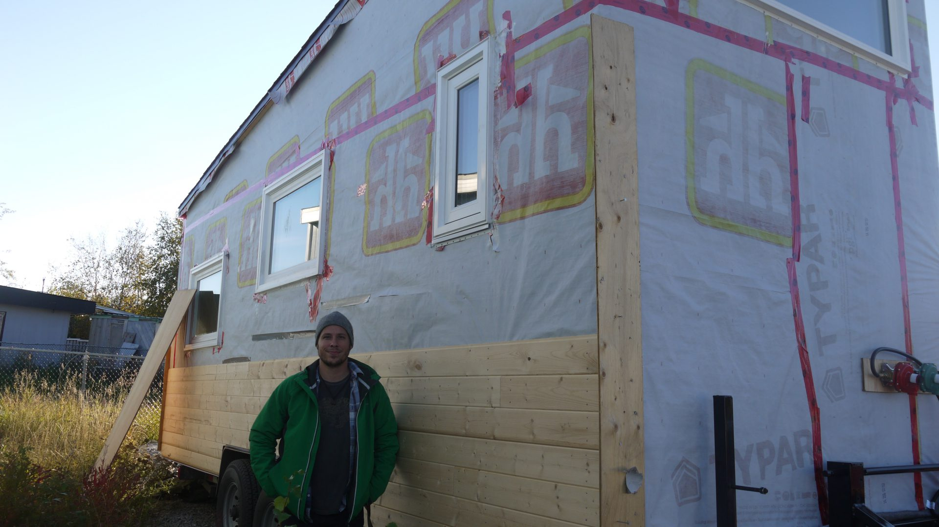 Croteau stands beside his 350-square foot tiny home. He said he was embarrassed the siding wasn't done, we think it looks great.
