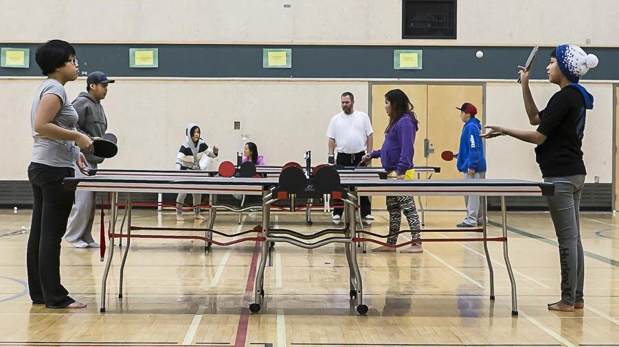 Children learning table tennis