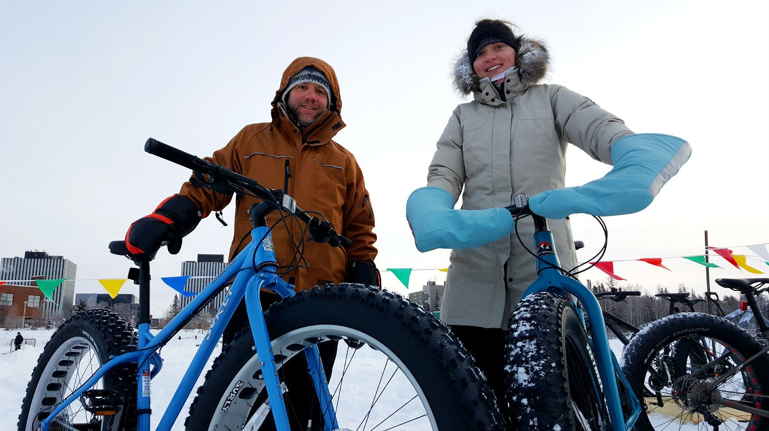 Overlander Sports staff pose with fat bikes during World Snow Day