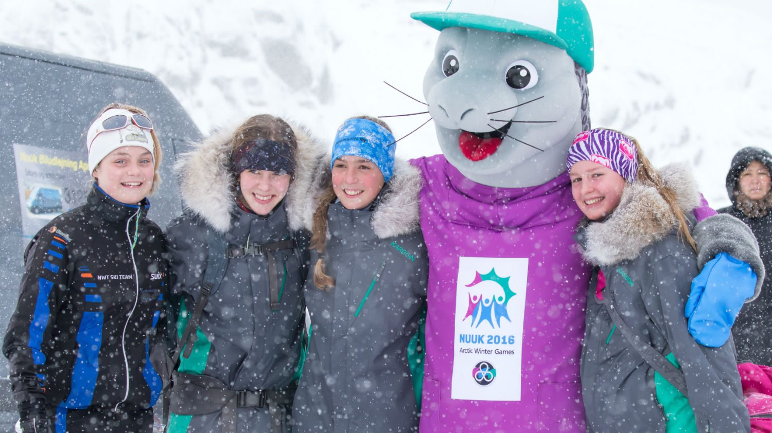 Skiers with mascot