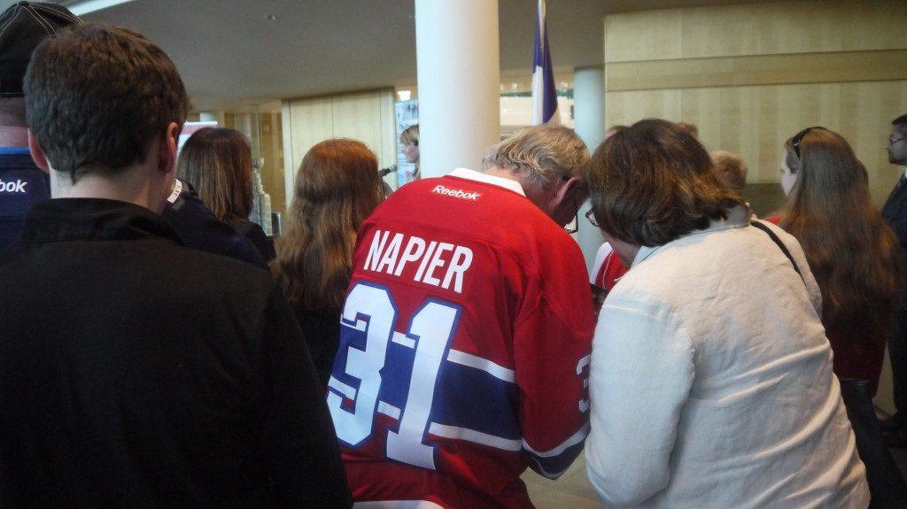 Napier signing autographs while Lanny speaks