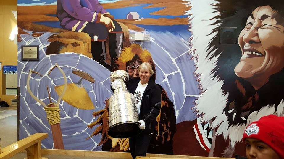 Phil Pritchard, the keeper of the Cup, brings the Stanley Cup out at the stop in Cambridge Bay. Photo courtesty of Project North Facebook group