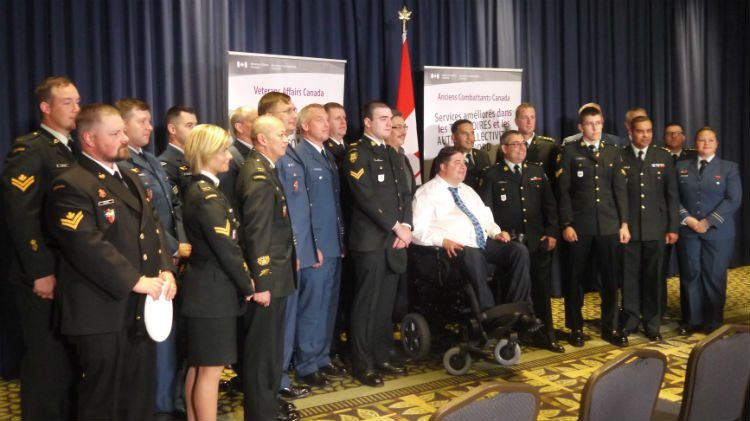 Minister Hehr with members of the armed forces.