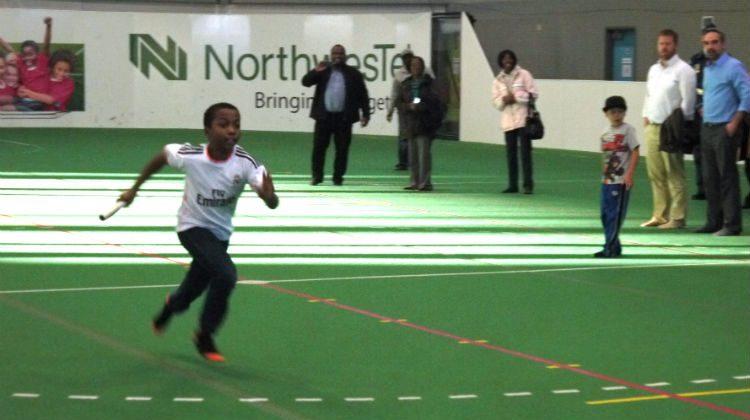 A boy runs during a fun the 4×100-meter race.