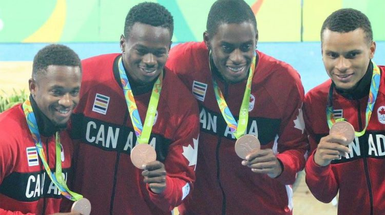 Akeem Haynes, left, Aaron Brown, Brendon Rodney and Andre De Grasse show off their 4x100-metre bronze medals in Rio.