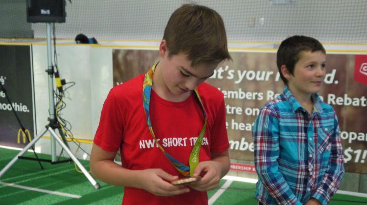 A fan examines Haynes' bronze medal.