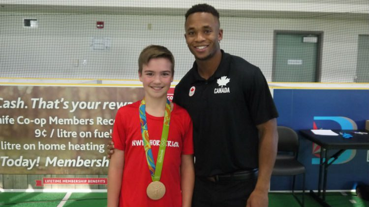 A fan takes a photo with Haynes while sporting his bronze medal.