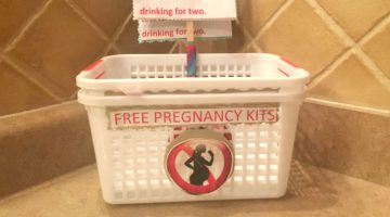 An empty bin where pregnancy kits were made available inside the women's restroom at Twist.