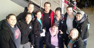 Members of the NWT Rebels pose with television personality Rick Mercer.