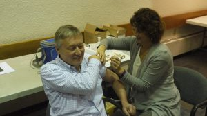 NWT Chief Public Health Officer Dr. André Corriveau receives his flu shot in Yellowknife Wednesday morning.