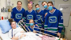 Maggie met members of the Vancouver Canucks while staying in hospital. Photo courtesy: Angela Betts-Rogers.