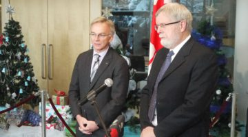 Sean Casey (left), parliamentary secretary to the federal minister of justice, stands beside NWT Justice Minister Louis Sebert.